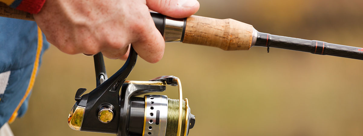 close-up-on-hand-and-fishing-pole