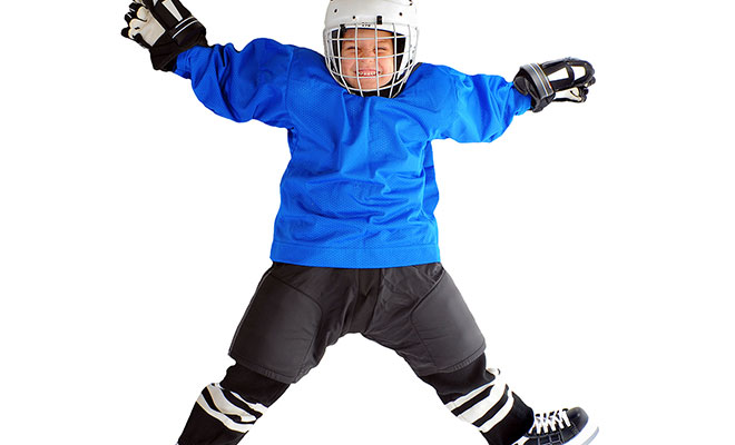 kid-jumping-in-hockey-gear