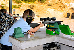Boy scoping rifle