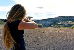 Girl aiming shotgun