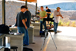 Men at rifle range