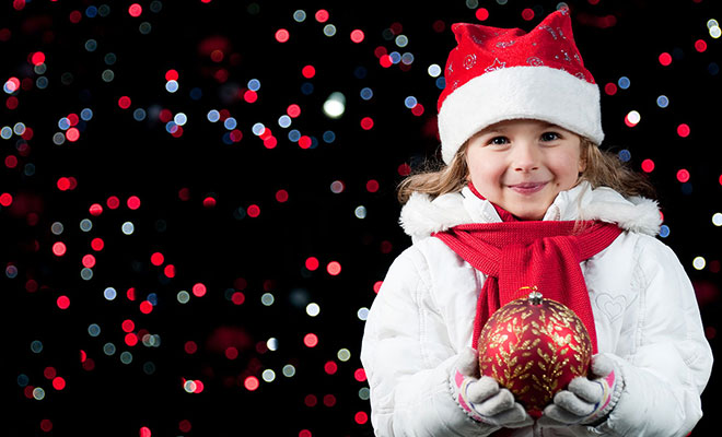 girl-holding-red-ornament