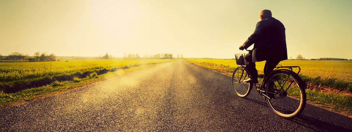 man-riding-bike-on-open-road