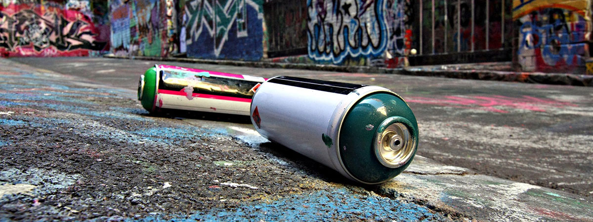 spraypaint-cans-on-ground