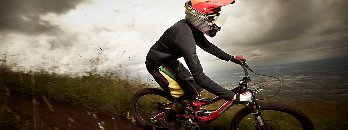biking-downhill-with-helmet-on