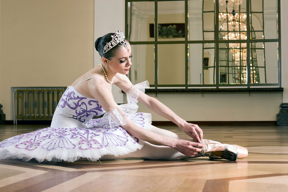 Ballet putting on shoes