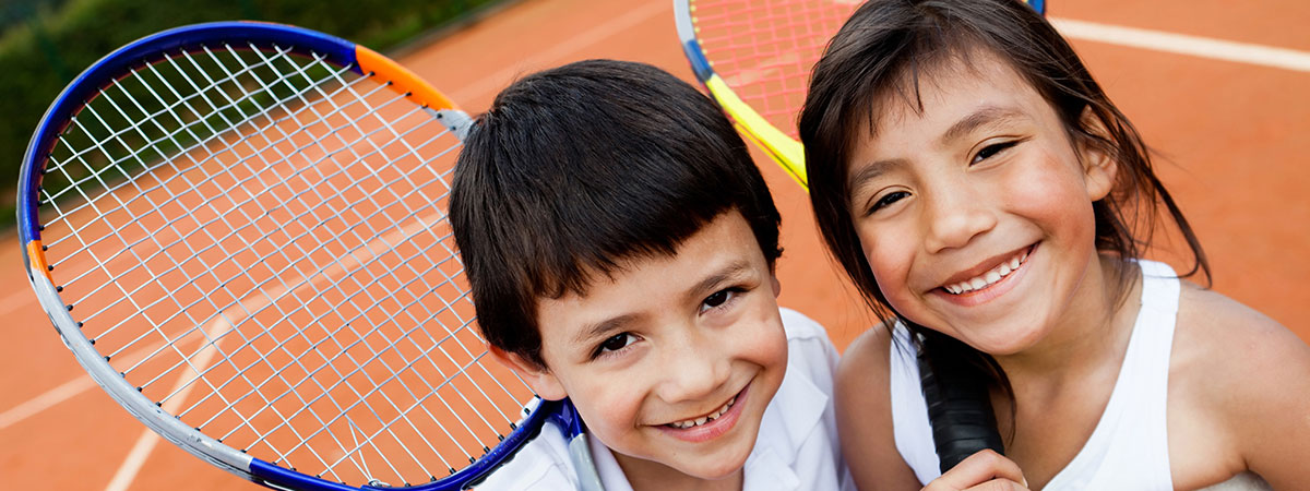 kids with tennis rackets
