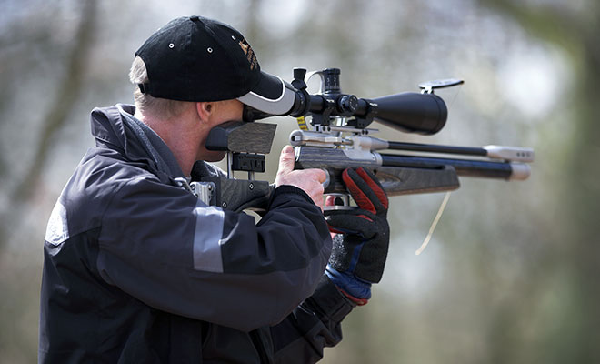 man-scoping-rifle