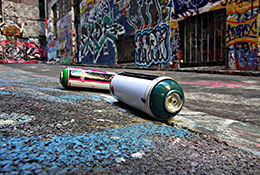 spraypaint cans on ground