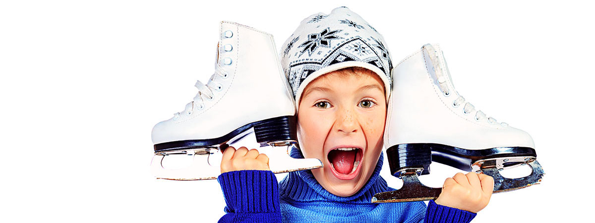 happy boy with ice skates