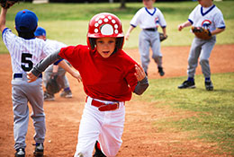 Kid running in baseball